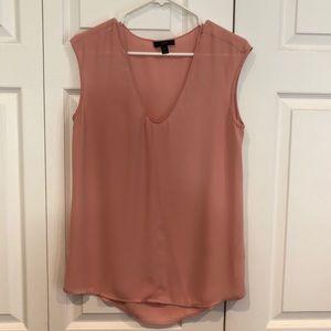 Sleeveless pink blouse